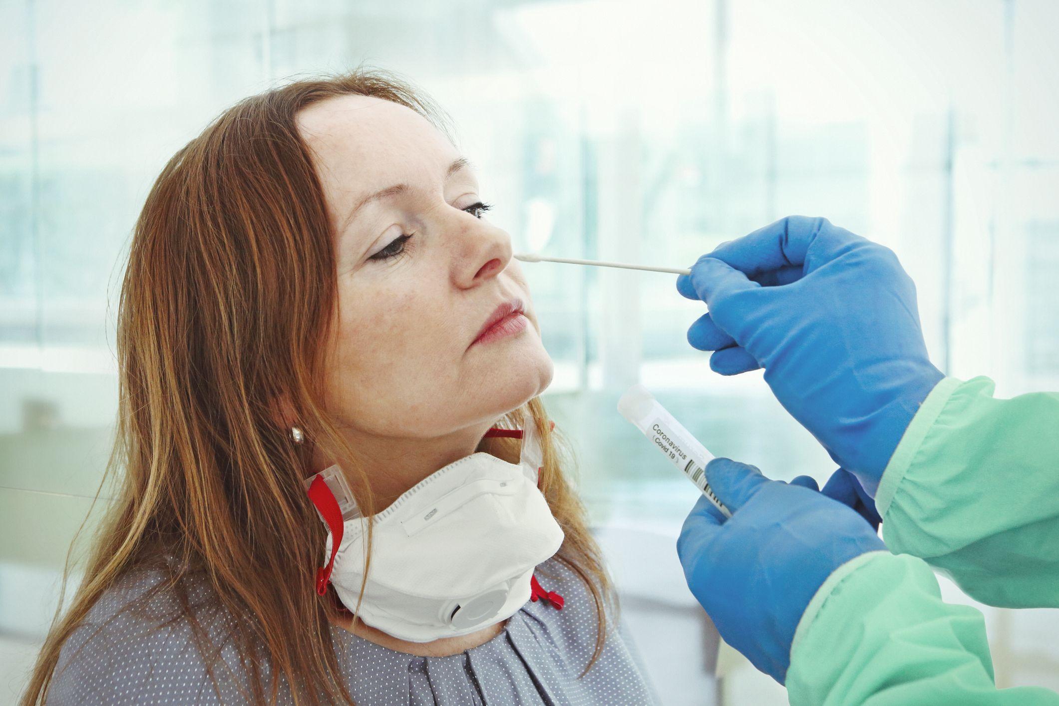 Women getting a COVID-19 test