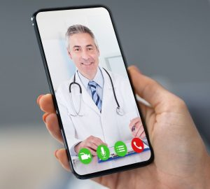 Telehealth call with a male doctor