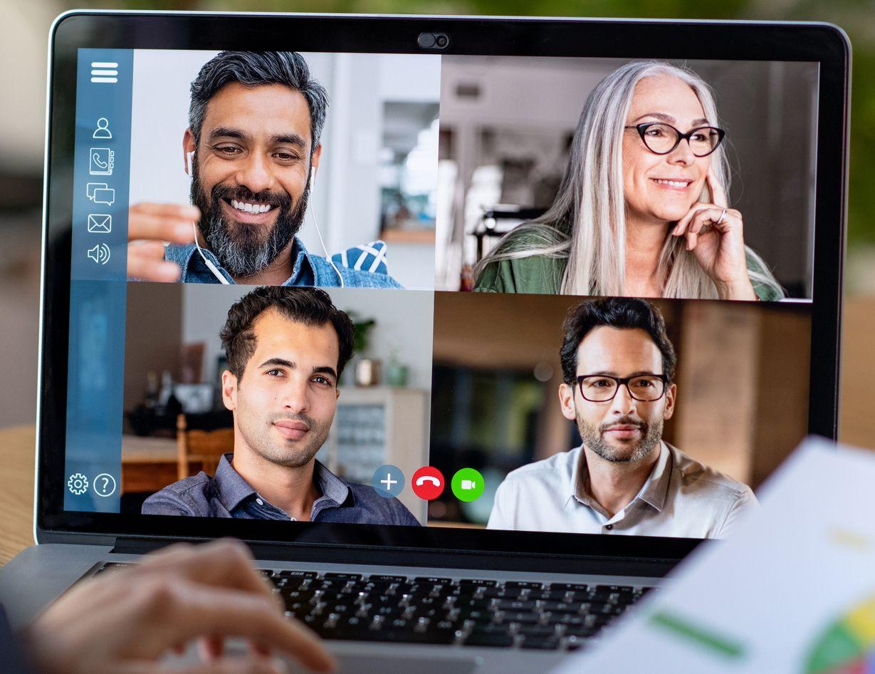 Four people having a virtual meeting
